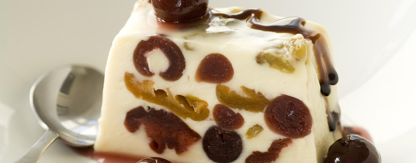 Vanilla panna cotta with cherries, plums & sultanas